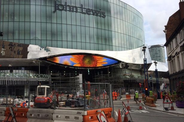 scanning eye-shaped big screen at Birmingham New Street railway station